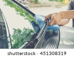 cleaning a windshield wiper... | Shutterstock . vector #451308319