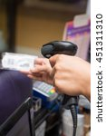 Small photo of Barcode Scanner in cashier hand