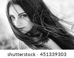 young girl with flying hair.... | Shutterstock . vector #451339303