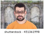 guy wearing glasses upside down | Shutterstock . vector #451361998