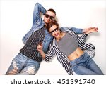 fashion couple in sunglasses... | Shutterstock . vector #451391740