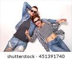 fashion couple in sunglasses... | Shutterstock . vector #451391740