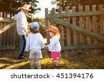 kids walk with grandfather in... | Shutterstock . vector #451394176