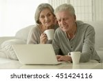 senior couple  with laptop   Shutterstock . vector #451424116