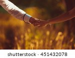 couple holds their hands... | Shutterstock . vector #451432078