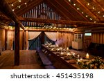 long table stands in the wooden ... | Shutterstock . vector #451435198