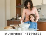 mother and daughter cooking in... | Shutterstock . vector #451446538