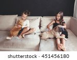 Stock photo home portrait of two cute children hugging with ginger cat and puppy of chinese shar pei dog on the 451456180