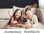 Stock photo home portrait of two cute children hugging with ginger cat and puppy of chinese shar pei dog on the 451456273