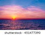 sunset over water burning skies  | Shutterstock . vector #451477390