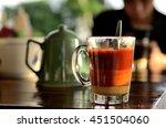 thai hot milk tea  cha ron  is... | Shutterstock . vector #451504060