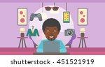 an african american man sitting ... | Shutterstock .eps vector #451521919
