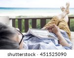 man resting to relax on the... | Shutterstock . vector #451525090
