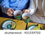 man and woman drinking black... | Shutterstock . vector #451539703