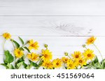 yellow flowers on light wooden... | Shutterstock . vector #451569064