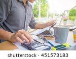 business man using a calculator ... | Shutterstock . vector #451573183