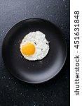 Fried Egg On Black Plate  Food...