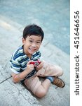 Happy Asian Boy With Camera At...