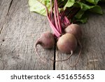 young fresh beets with tops on... | Shutterstock . vector #451655653