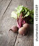 young fresh beets with tops on... | Shutterstock . vector #451655689