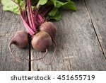 young fresh beets with tops on... | Shutterstock . vector #451655719