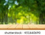 wood table top on shiny bokeh... | Shutterstock . vector #451660690