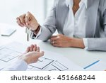 business broker giving keys to... | Shutterstock . vector #451668244
