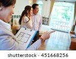 realtor with blueprint in her... | Shutterstock . vector #451668256