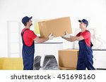 male workers with boxes and... | Shutterstock . vector #451698160