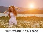 beautiful woman enjoying daisy... | Shutterstock . vector #451712668