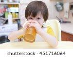 lovely 2 years child drinks... | Shutterstock . vector #451716064