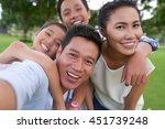 happy vietnamese family hugging ...   Shutterstock . vector #451739248