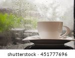 coffee cup on rainy day | Shutterstock . vector #451777696