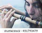 Musician Playing A Wooden Flut...