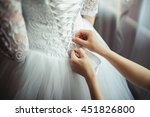 bridesmaid makes bow knot on...   Shutterstock . vector #451826800
