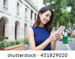 woman using mobile phone at...   Shutterstock . vector #451829020