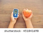 hands hold glucometer and fruit.... | Shutterstock . vector #451841698
