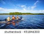 Motor Boat With People On A Lake