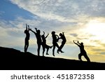 silhouette of friends jumping... | Shutterstock . vector #451872358
