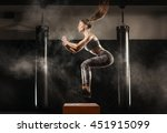 sporty girl jumping over some... | Shutterstock . vector #451915099