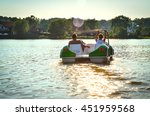 The Couple On The Pedal Boat O...