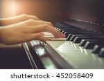 musician playing piano in... | Shutterstock . vector #452058409