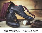 tie  shoes and watch on wooden... | Shutterstock . vector #452065639