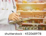male doctor  pharmacist with... | Shutterstock . vector #452068978