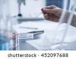 scoop the white powder with a...   Shutterstock . vector #452097688