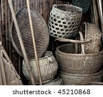 Vintage baskets and other tools used on an old Chinese salt farm - stock photo