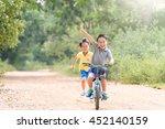 young asian boy ride a blue... | Shutterstock . vector #452140159