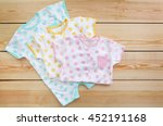 new baby clothes on wooden... | Shutterstock . vector #452191168