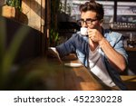 man drinking a cup of coffee in ... | Shutterstock . vector #452230228