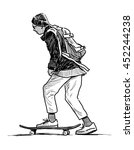 schoolboy rides on a skateboard | Shutterstock . vector #452244238